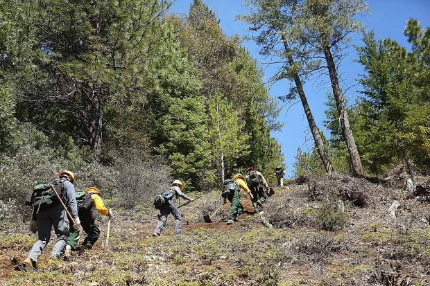 After creating the fire line, the firefighter trainees must then hike out of the steep canyon that they traveled down.